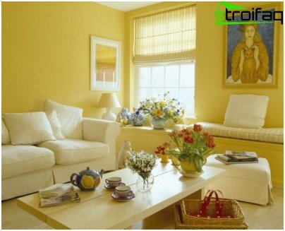 The yellow color of the walls in the living room