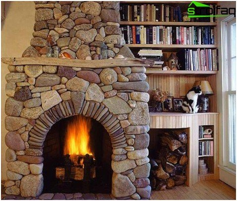 Fireplace of river pebbles in the living room