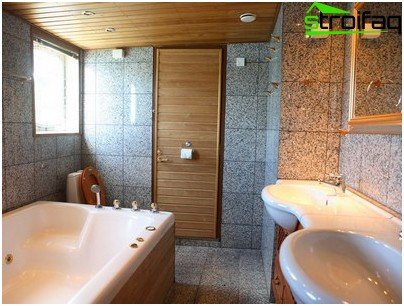 The ceiling is made of wooden panels in the bathroom