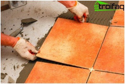 Laying floor tiles