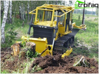 uprooting stumps tractor
