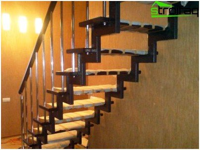 A metal staircase with wooden steps