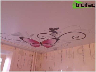 Stretch ceiling in the room of a teenage girl with a picture of a butterfly