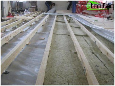 Laying insulation between joists