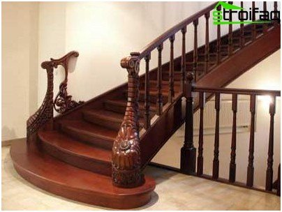 Carved decorations transform the railing into a masterpiece