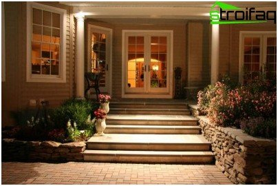 Architectural lighting the entrance to the house
