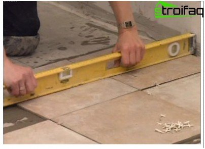 Laying tiles on the floor
