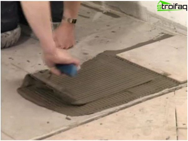 Apply the adhesive under the tile