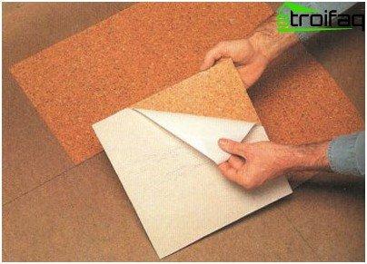 Tile on the basis of self-adhesive