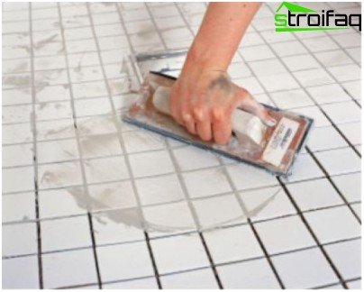 Grouting between tiles