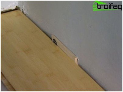 Leave a space between the wall and the sheet laminate