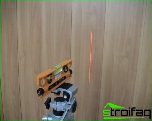 Laser Level with their hands