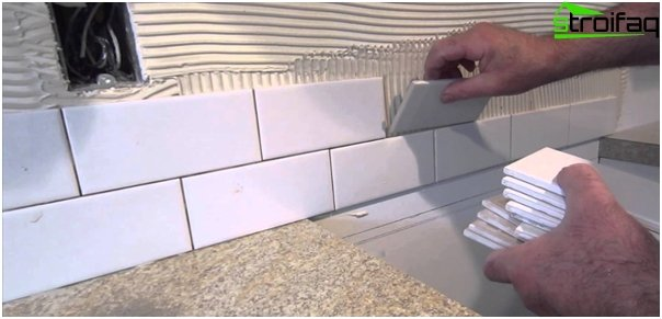 Tile in kitchen interior (with their hands) - 1