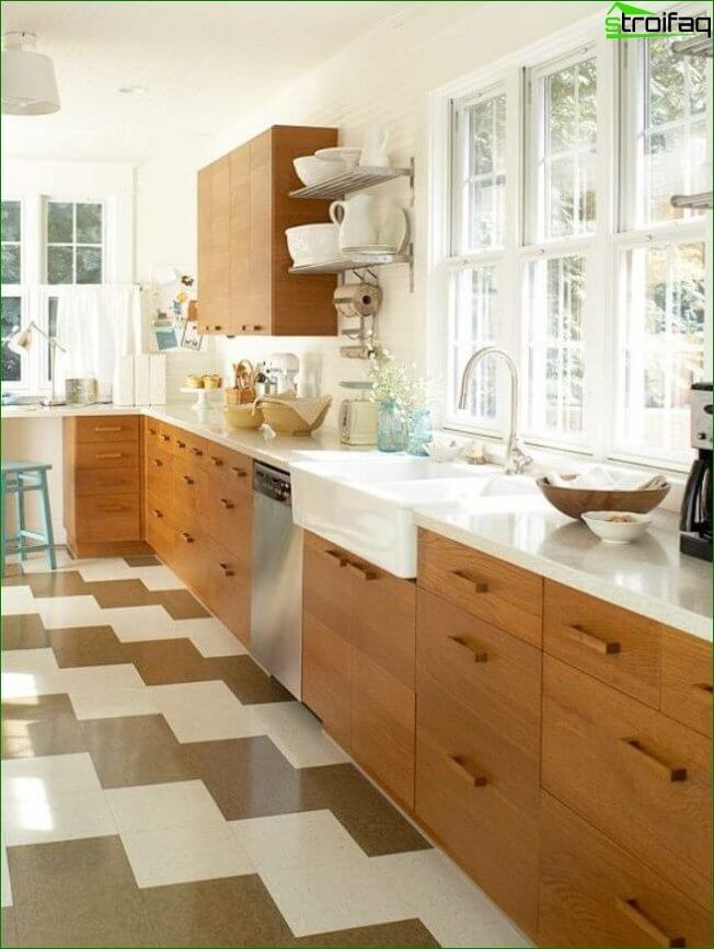 Spacious kitchen in light colors with a practical window sill, countertop