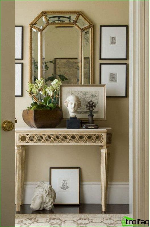 Facet mirror over a console table in the hallway