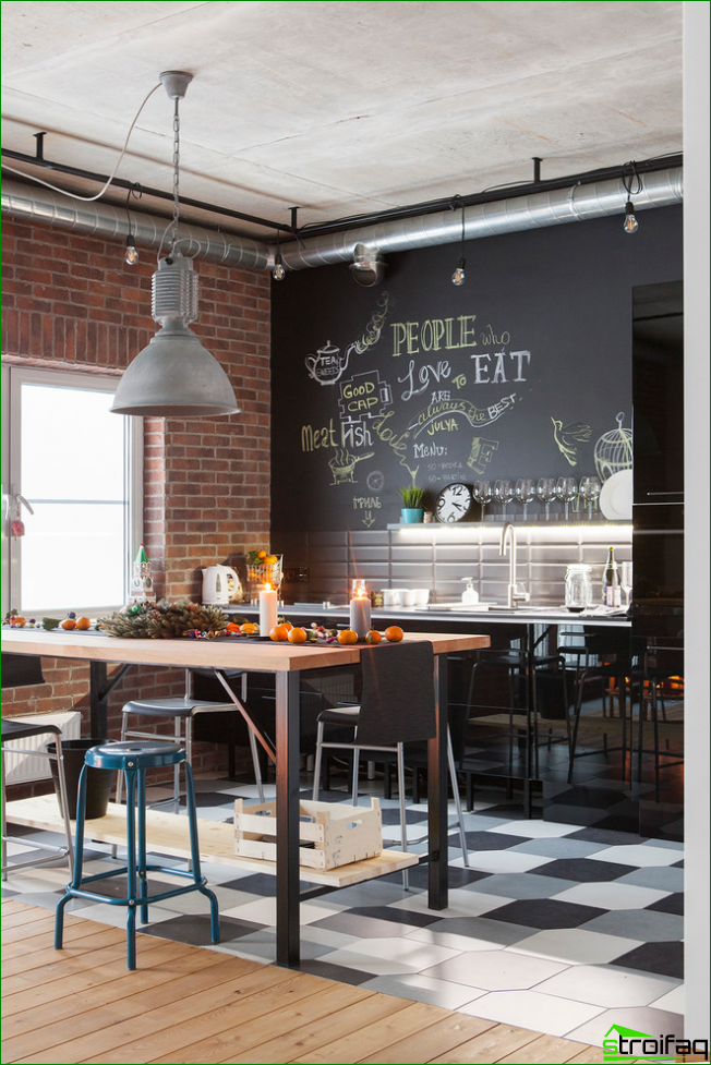 The kitchen is decorated in the style of a loft Painted black wall