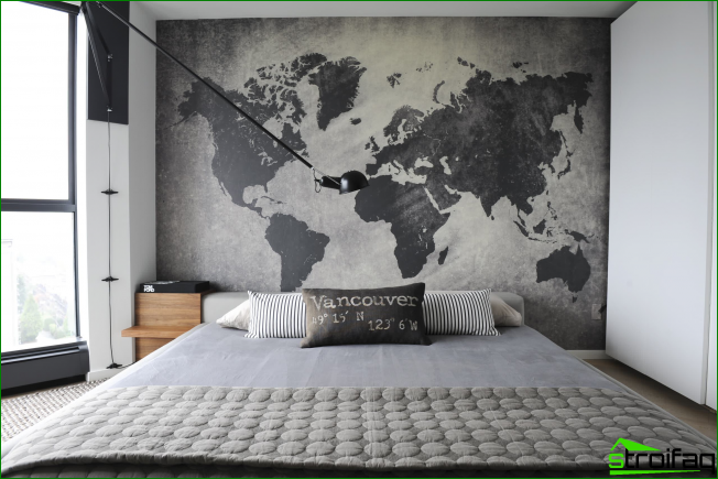Atmospheric bedroom in the loft spirit. Very harmonious in the interior of the graph looks like a large world map on the wall