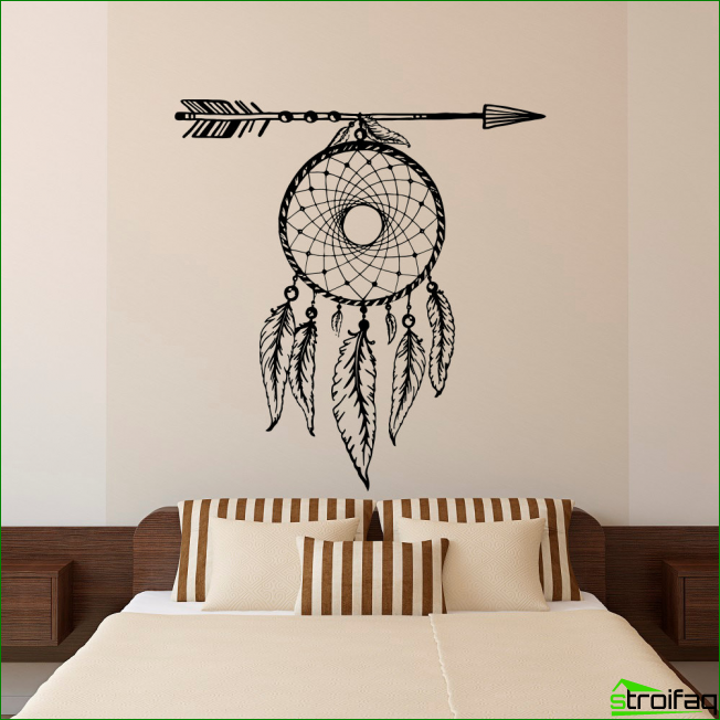 Dreamcatcher above the headboard in the bedroom in soft cream colors