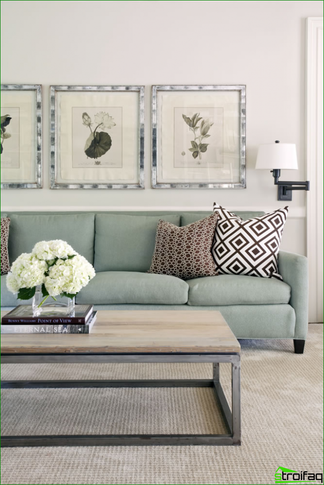 Small living room in pastel colors with graphic elements on the lining of pillows and soft patterns within