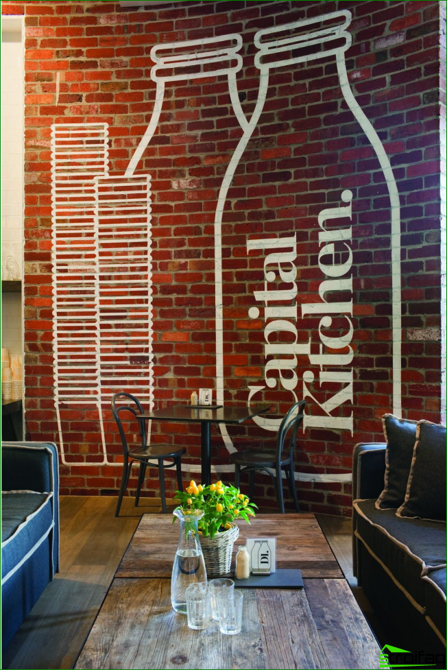 Very atmospheric loft premises with brickwork on the wall and a large graphic pattern white