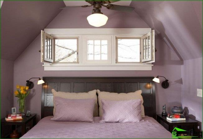 Especially romantic bed headboard to the window looks into a small bedroom in the attic