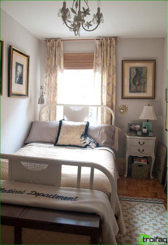 Bed headboard to the window and near the wall - the only possible way to make the room more comfortable