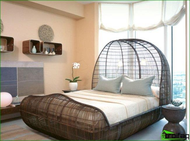 Panoramic windows in the circular room creates additional space for a bed