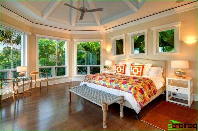 Interior corner bedroom with rounded walls and many windows