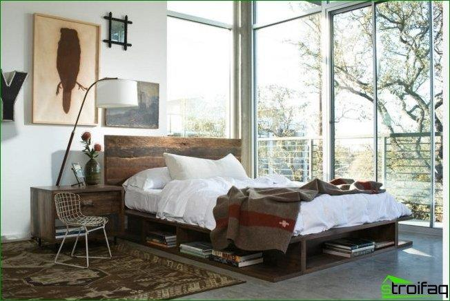 Bed headboard to the window: Corner bedroom in a modern spirit with panoramic windows in a country house