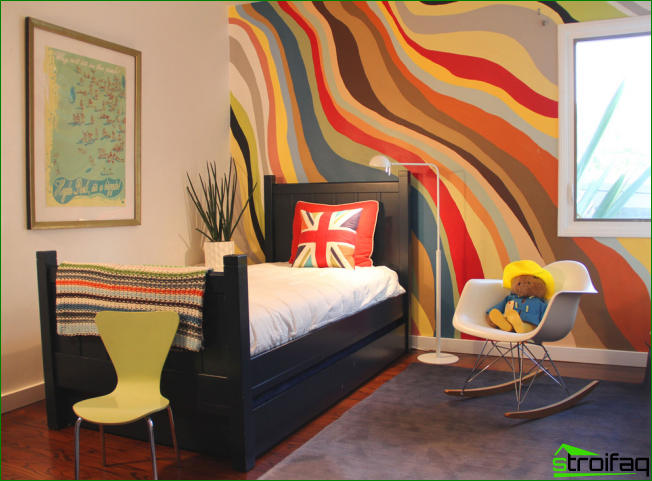 The bright panels of wallpaper on the wall dedicated bedside