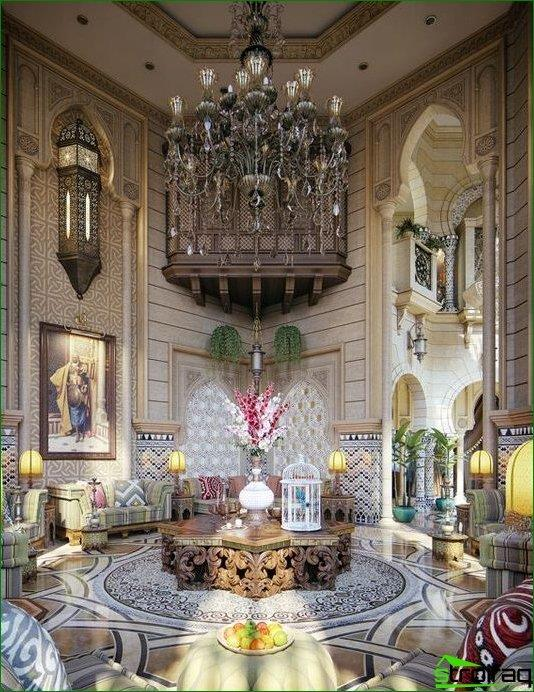 The Moroccan-style interior Maharajas surprise forged and carved elements, luxurious patterned lights, painted walls, colorful cushions and green plants as decorations