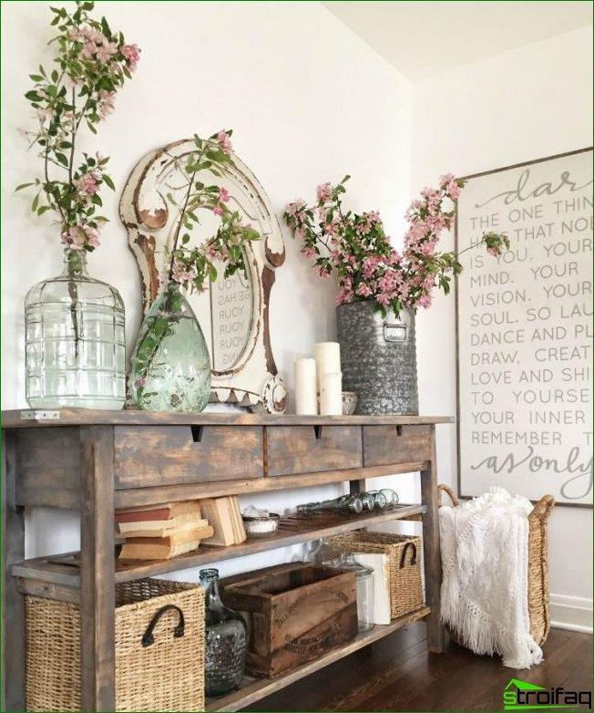 Console table in the hall in the style of Provence is sure to have open shelves, which store the picture, things in wicker baskets and other essential accessories
