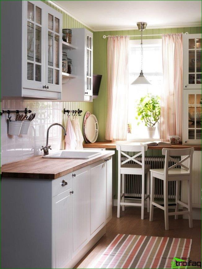 To save space in a small kitchen, you can make a countertop sill-like dining area