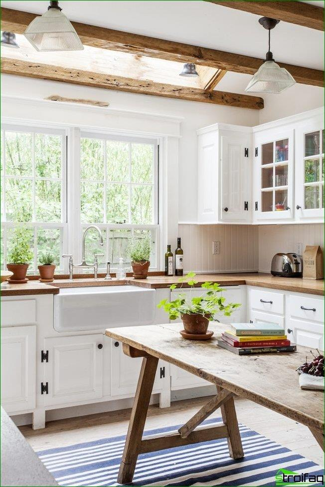 Bright kitchen with colorful accents on wooden furniture items. Notice how the window sill, countertop smoothly into the kitchen unit