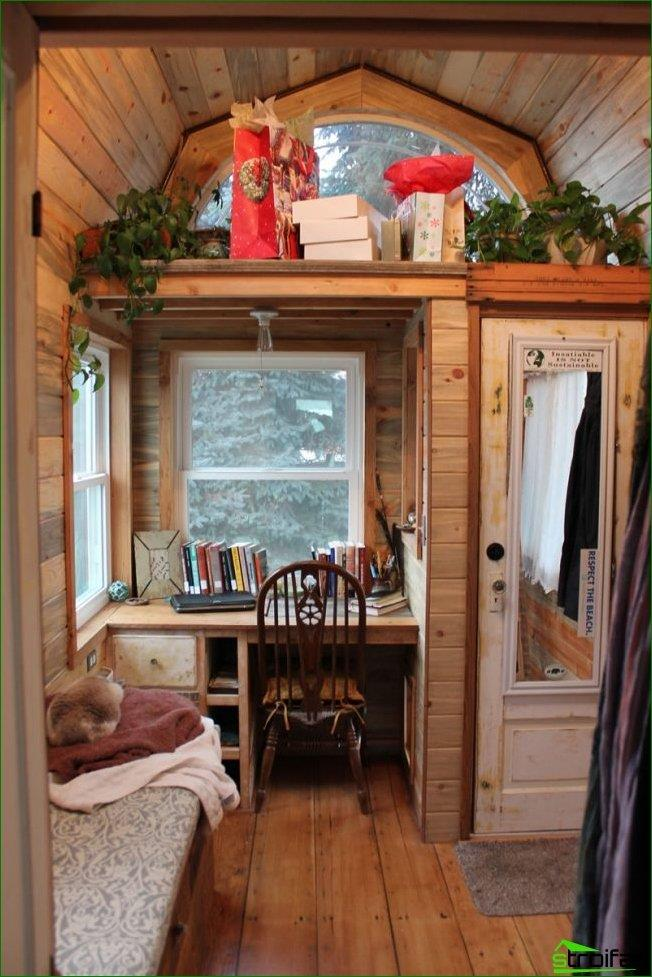 Very cozy alternative design workspace, based on the window sill, countertop, in the hallway of a private house in the country