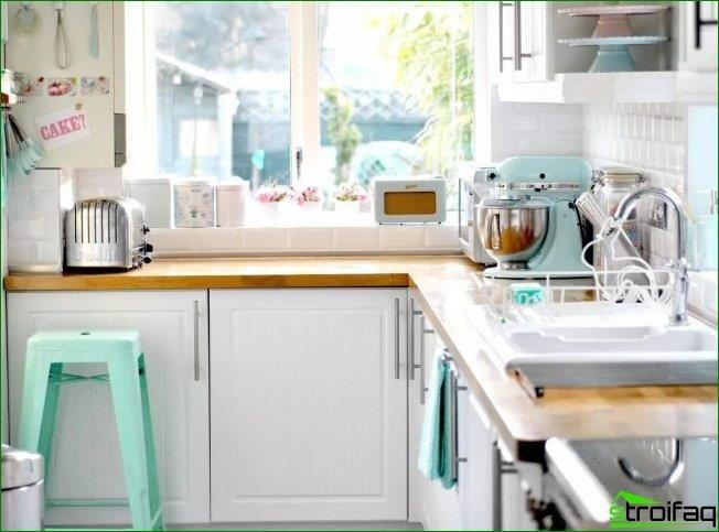 The kitchen set under a window sill, countertop, you can build the necessary electrical