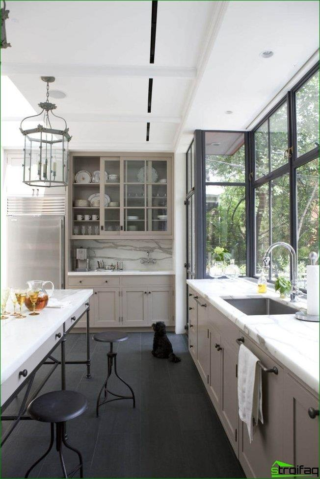 Sill-countertop looks very harmoniously in the kitchen with large panoramic windows on the wall