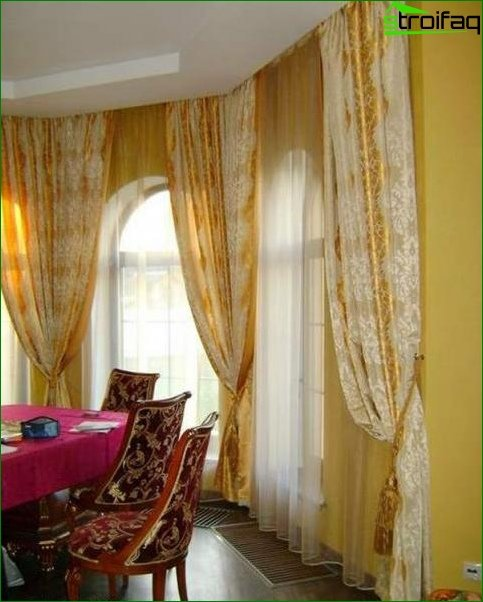 Curtains design in the living room with two windows