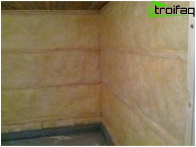 Insulation of the walls of the bath