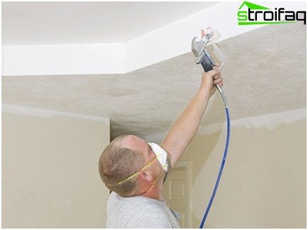 Painting the ceiling with a spray gun