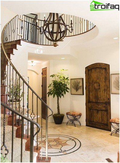 A graceful spiral staircase makes the interior stylish and complete, but for small children and elderly family members it is inconvenient and even dangerous
