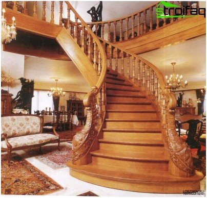 Carvings, chiseled balusters, complex sculptural groups are integral attributes of a wooden staircase in a classic style.