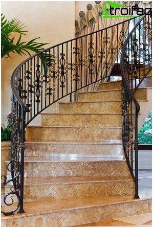 Staircase with elegant wrought iron balustrade - view