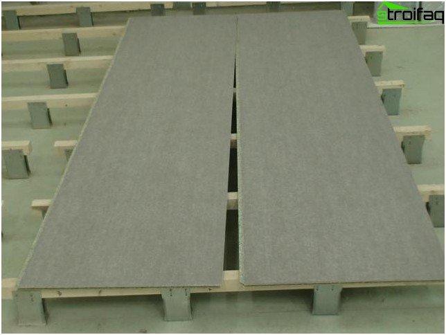Nivelación del piso con tableros de partículas adheridos con cemento