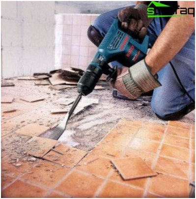 Removing floor tiles with a punch