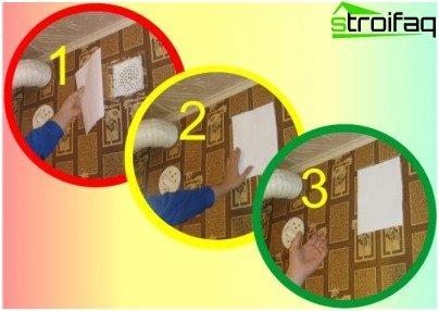 Проверка на вентилацията с лист хартия: въздушният поток държи хартията на решетката, вентилацията работи добре