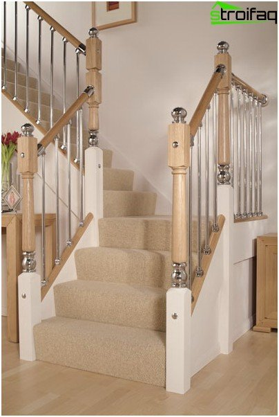 Strict laconic balusters for stairs made of stainless steel go well with wood, glass, stone