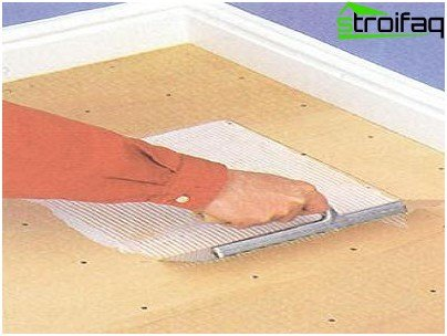 Glue application with a notched trowel