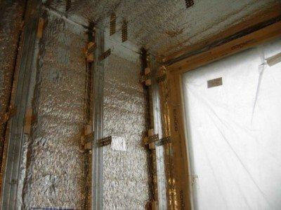 Laying vapor barrier walls
