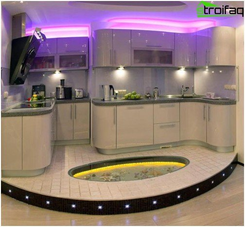 A spectacular combination of tile and glass insert with LED lighting on the kitchen floor